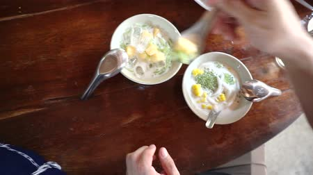 point of view pov : Point of view of hand eating Thai dessert cuisine from top. Coconut milk sweet POV Stock Footage