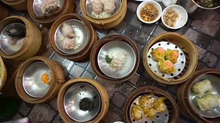 bamboo steamer : Steaming Dim Sum eating, top view point of variety traditional Chinese food