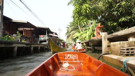 ratchaburi : POV of tourist, point of view boat ride through a floating boat market in Thailand Stock Footage