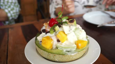 kübalı : Delicious fruit salad in cantaloupe bowl. Scooped grapes,water melon,melon and salad dressing healthy food