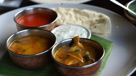 tikka : Indian curries different color and nan bread serve in restaurant