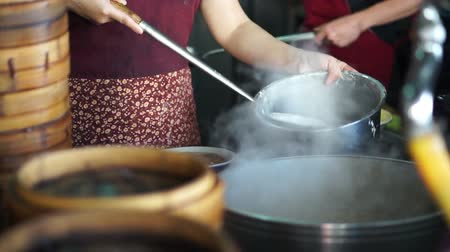 bamboo steamer : Steaming Dim Sum bamboo trays in different layers traditional Chinese food