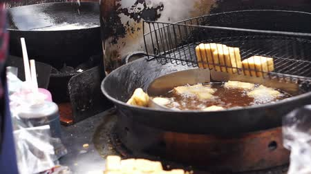 mal cheiroso : Man fried stinky tofu in oil pot. Famous and iconic fermented tofu of Taiwan