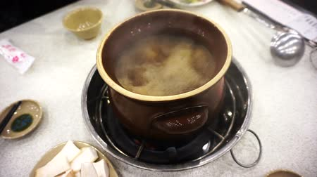 hotpot : Taiwanese, Chinese food ginger duck hot pot in clay pot Stock Footage