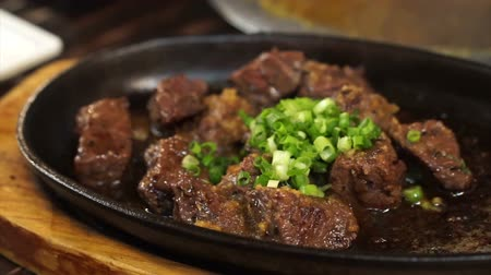 wagyu : Japanese harami beef steak cut on sizzling pan in Izakaya restaurant style Stock Footage