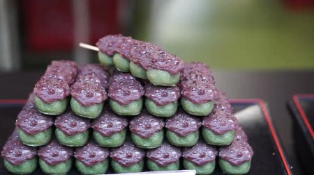 rice cake : Japanese traditional dessert Dango, green tea with red bean and Mitarashi dango