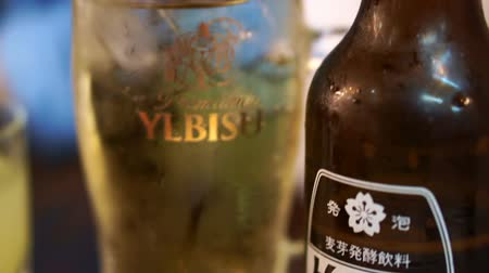 nihon : Tokyo, Japan - September 2016: Japanese Hoppy drink. A beer flavored almost non alcoholic drink. Sake in Yebisu glass