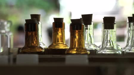 perfume bottle : Homemade craft essence perfume or oil fragrant container bottles in rows