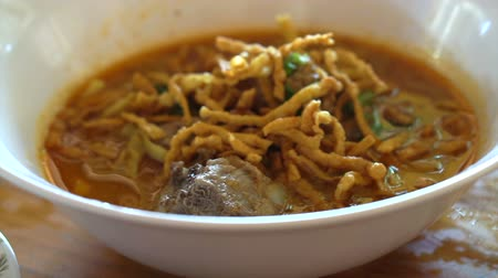 galuska : Northern Thai curry noodle, Khoa Soi or Khao soy. Local traditional food of Chiang Mai Stock mozgókép