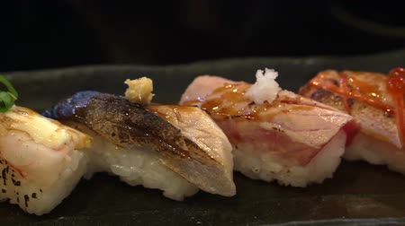 sararmış : Aburi nigiri set or seared sushi set. Japanese food, raw fish with fast fire burn