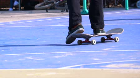trik : A man playing skateboard trick on concrete floor in slow motion