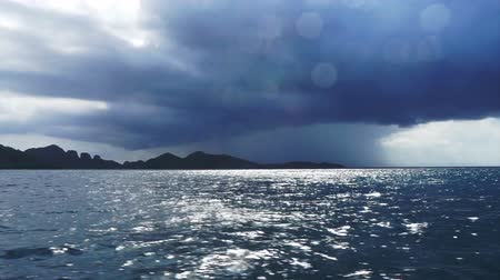 typhoon : Real storm windy and raining shot in dark blue ocean. Shot with water droplet on camera while boat running