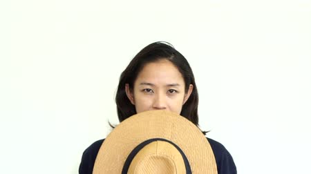 olumsuzluk : Young Asian woman showing angry expression. Face and emotion change behind the hat