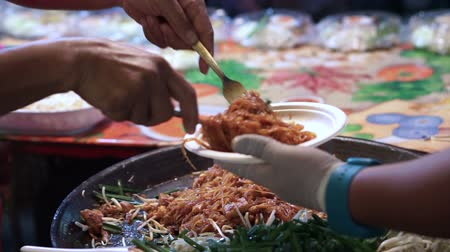 tofu : Pad thai selling at night market putting in plate for tourist in Bangkok