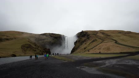 skogafoss : Iceland, April 2017 - Tourist travel to see majestic water fall in Iceland, Europe Stock Footage