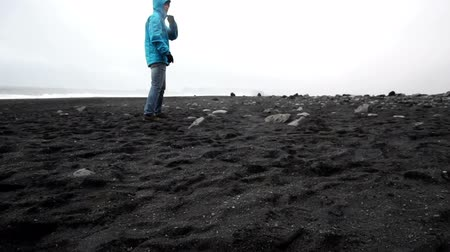 iceberg : Tourist man explore Iceland black beach slow motion video