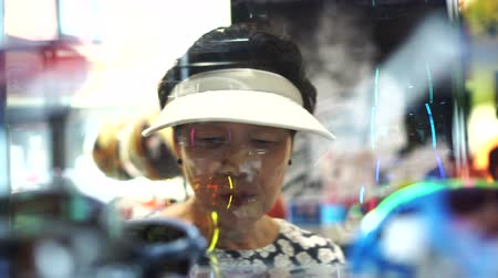from behind : Asian senior Chinese tourist window shopping 4k video Stock Footage