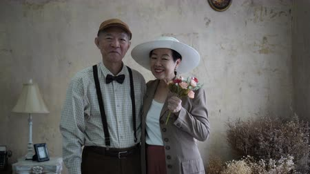 lasting : Asian senior couple celebrate Valentines day flower dating love