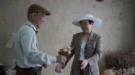 geçen : Asian senior couple celebrate Valentines day flower dating love