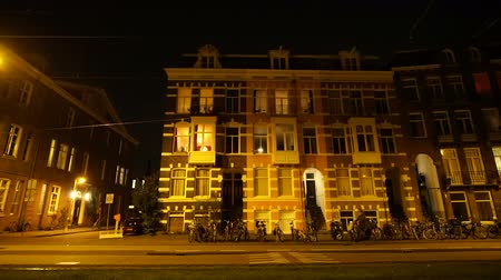 outbound : Amsterdam, Netherlands : 5 April 2017 - Night evening street view of local life in the city, apartment street and people