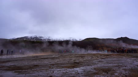 gushing : People waiting for geyser explode in Iceland Stock Footage