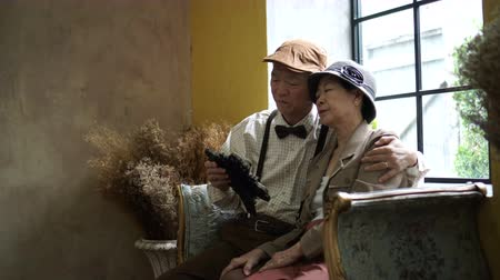 remember : Sad Asian senior couple looking at memory photo frame