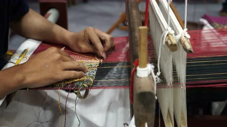 húr : Handmade traditional silk weaving in Asia video Stock mozgókép