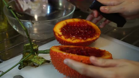 spiny : Gac fruit cut open, red healthy antioxidant food video Stock Footage
