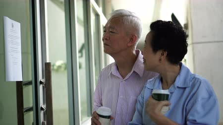 sme : Asian elderly couple looking for space rental to start SME business, active senior