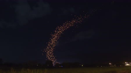 uzak : Mass Lantern Release, yi peng, loy krattong festival, floating thousands of lamps in Thailand amazing view from far away Stok Video