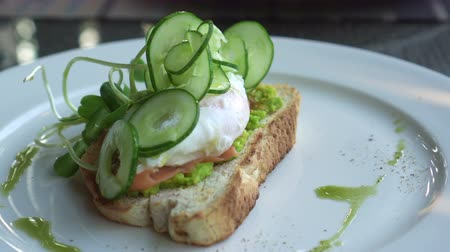 poached egg : Eating Pesto Smoked Salmon Avocado paste and Poached Egg 4 K Stock Footage