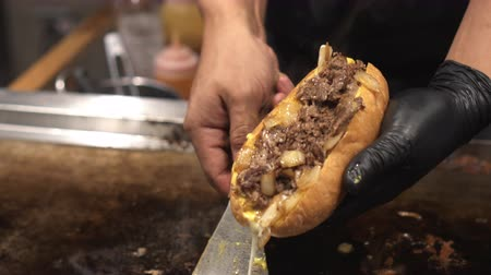 engorda : Cooking Philly Beef Cheese Steak On Hot Plate Stock Footage