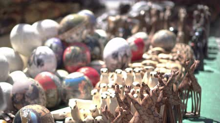 avestruz : South Africa Souvenir Stall At Flea Market Ostrich Egg Paint And Animal Wood Sculpture Stock Footage