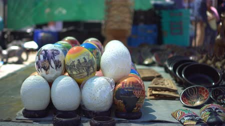 avestruz : South Africa Souvenir Stall At Flea Market Ostrich Egg Paint And Tribal Mask