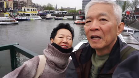 шестидесятые годы : Asian Senior Couple Try Selfie Photography Together Travel Trip