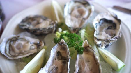 south asian food : Eating Fresh South Africa Oyster with lemon platter Stock Footage