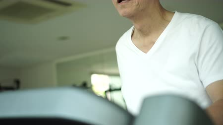 senior lifestyle : Asian Senior Exercise Walking Threadmill In Air Condition Gym