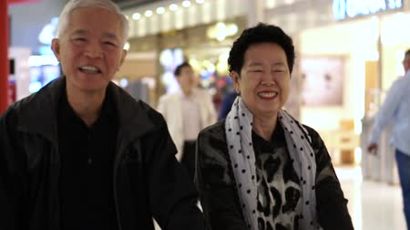 troli : Asian Senior Couple Happy In Airport Duty Free Fun Trip