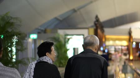 troli : Asian Senior Couple Happy In Airport Fun Trip