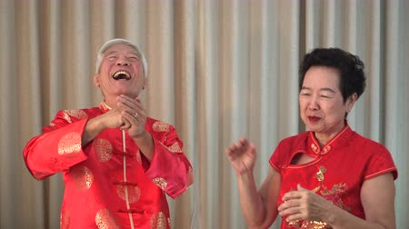 gong : Asian Chinese Senior Couple Playful In Lanar New Year Happy Family
