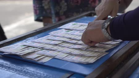 esély : Hands Picking Lottery Buying And Hope To Win Stock mozgókép