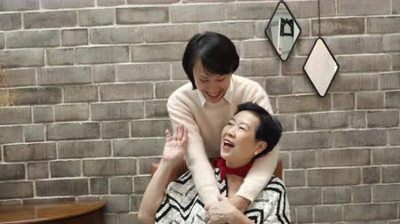 home grown : Asian Adult Daughter Hugging Play With Mother
