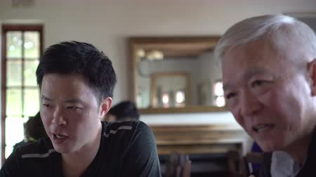 rendes : Asian Father And Adult Son Talking On Regular Topic At Dinning Table Stock mozgókép