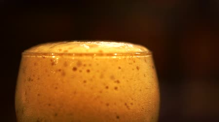 quartilho : Close Up Beer Foam At Glass Edge At Bar Lighting Stock Footage
