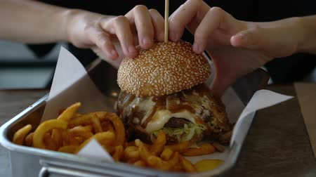 marul : Hands Picking Up Big Delicious Fresh Cook Melty Cheese Burger