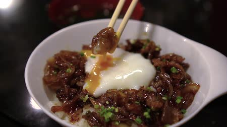 wagyu : Dipping Beef In Egg Yolk Gyudon Beef Over Rice Japanese Style Eating Stock Footage