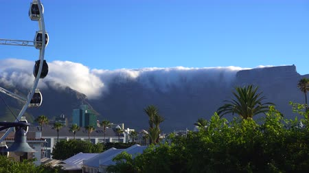 cape wheel : Table mountain table cloth view from V&A waterfront famous Souht Africa landmarks Stock Footage