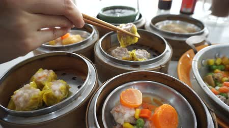 bamboo steamer : Eating Dim Sum breakfast in Thailand Chinese food