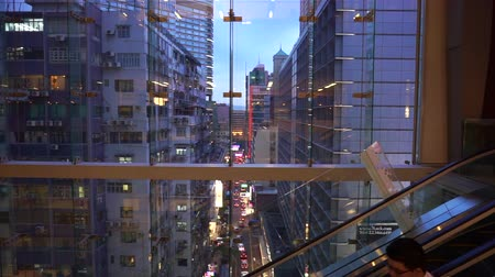 levendig : Hong Kong - 26 Apr 2016 : View Of Evening Modern City From Inside Commercial Building Stockvideo