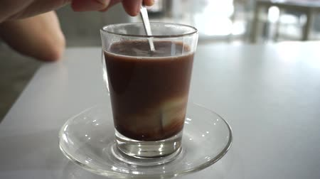 condensed : Mixing Vietnamese style coffee with condensed sweet milk morning routine cafe Stock Footage